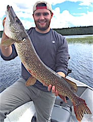 Jim With a Very Large Northern Pike Fishing at Fireside Lodge